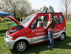 Public Relations major Jennifer Napolitano checks out a new no-gas, electric-generated car.