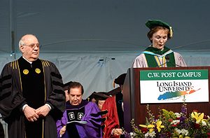 Frank F. Villano receives a Distinguished Alumni Award from C.W. Post Chancellor Tess Mullarkey.