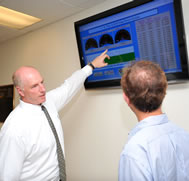 William Kirker shows a new TV monitor displays the energy saved