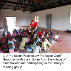 LIU Professor Psychology Professor Geoff Goodman with the children from the village of Gulema who are participating in the library's reading group.