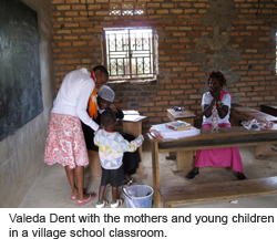Valeda Dent with the mothers and young children in a village school classroom.