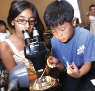 Children around microscope