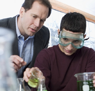 Teacher and Student in Chemistry Lab