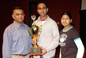Varun Talanki, a junior at Ward Melville High School, took first place in the Long Island Brain Bee at C.W. Post Feb. 10, 2007. He advances to the International Brain Bee at the University of Maryland March 16-17. To his left is his father, Raveesh Talanki. To his right is his sister, Veda Talanki.