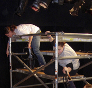 Two students on scaffolds