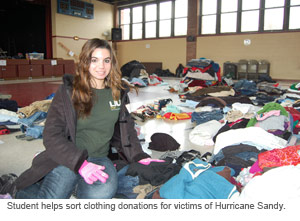 Student helping with clothing for Sandy victims.